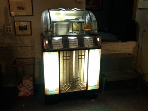 A 1954 Jukebox, left behind, plays only 50's tunes.
